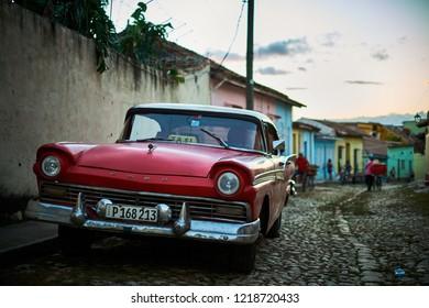CUBA, TRINIDAD - NOVEMBER 07,2017: Vintage cars parking on the old street of Trinidad