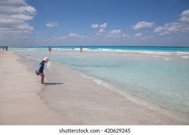 CUBA, VARADERO - MARCH 09: Varadero beach  in 2013. Azure ocean. The unidentified child and people on the beach and in the water