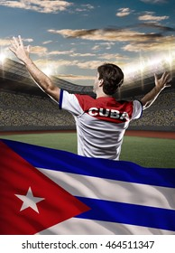 Cuban Athlete Winning a golden medal with a cuban flag in front.