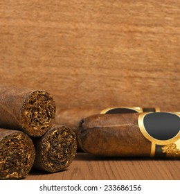 Cuban cigars on wooden background