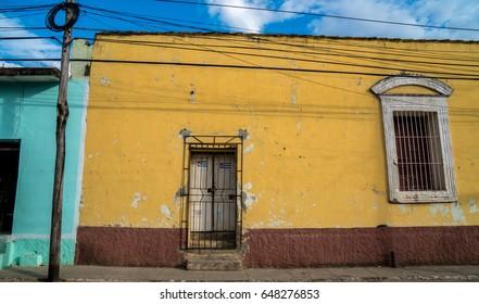 Cuban Colorful house, Cuban Flag on the door Trinidad, Cuba