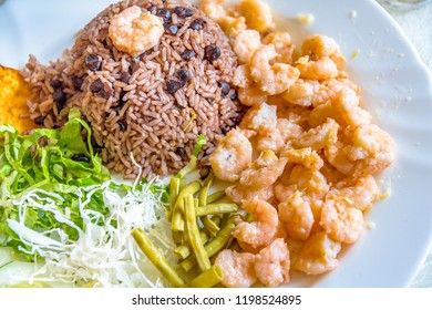 Cuban cuisine: Traditional dish made with shrimps, rice cooked with beans, and a garden salad