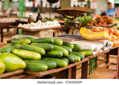 Cuban farmers market with garlic, beans, and  vegetables for sale