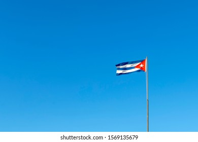 cuban flag with a blue sky in the background