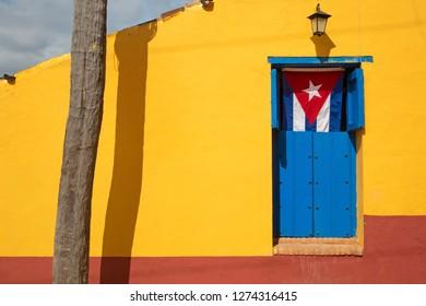 Cuban flag exposed in house door
