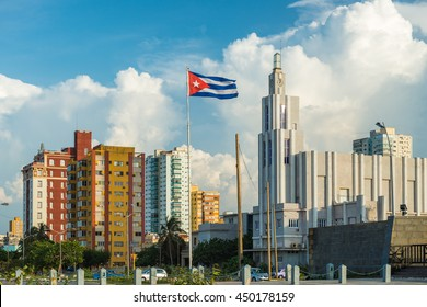 A Cuban flag flies above the streets of the Vedado district in Havana, Cuba.