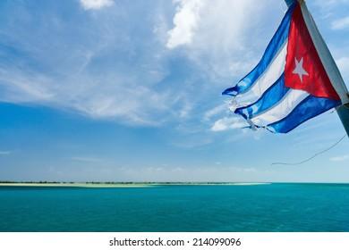 Cuban flag over the sea and sky