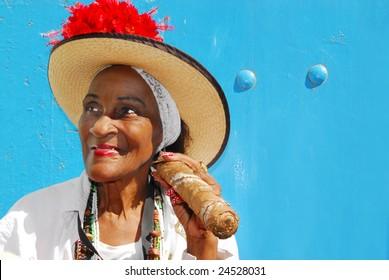 Cuban lady with big cigar in the streets of Havana, Cuba
