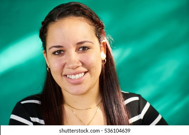 Cuban people and emotions, portrait of latina girl laughing and looking at camera. Happy hispanic young woman from Havana, Cuba, smiling