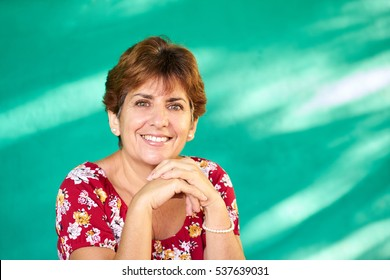 Cuban people and emotions, portrait of latina lady laughing and looking at camera. Happy hispanic woman from Havana, Cuba smiling