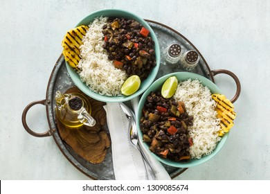 Cuban rice and black bean dish with grilled pineapple. Healthy Vegan Caribbean food for the whole family, party or restaurant menu