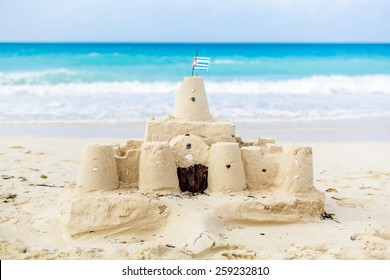 Cuban Sandcastle with the country Flag on one of the most Beautiful Beach of Cuba