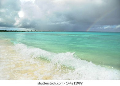 Cuban shore with stormy clouds and rainbow