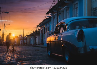 Cuban street sunset with oldtimer in Trinidad, Cuba