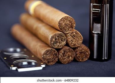 Cuban top cigars with lighter and cutter