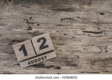 cube calendar for august on wooden surface with copy space