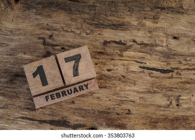cube calendar for february on wooden surface with copy space