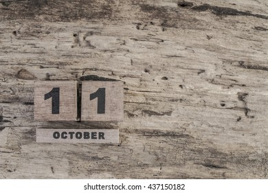 cube calendar for october on wooden background with copy space