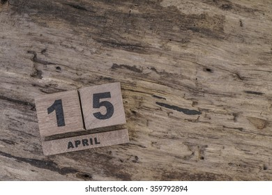 cube calendar on wooden surface for april with copy space