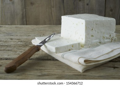 cube of fresh feta cheese on a  cheesecloth