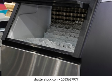 cube ice in ice making machine that door open ; food industrial background ; close up