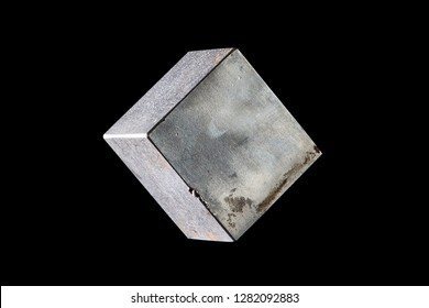The cube of metal on a black background