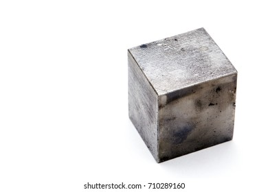 A cube of metal on white background