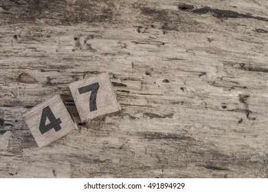 cube numbers on wooden surface with copy space ( forty seven )
