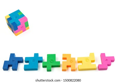 Cube puzzle of multi-colored rubber shapes. Concept of decision making process, creative, logical thinking. Logical tasks. Conundrum, find the missing piece of the proposed.