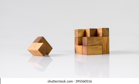 Cube puzzle wooden blocks isolated on white or empty background. Slightly de-focused and close-up shot. Copy space.