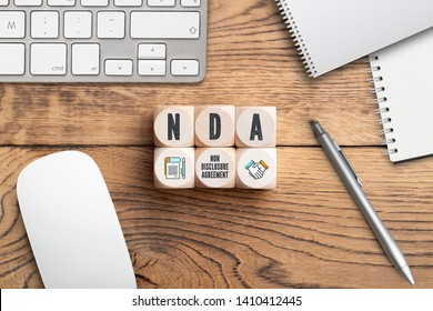 "Cubes with acronym NDA for ""non disclosure agreement"" on wooden background"