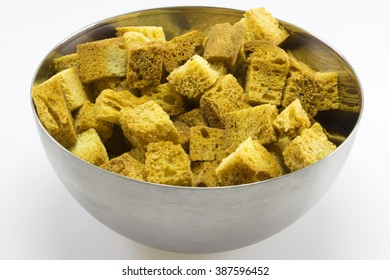 Cubes of bread croutons of white bread for cream soupsStainless steel bowl with toast croutons