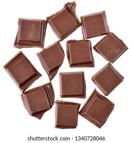 Cubes of chocolate top view isolated on a white background.