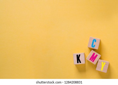 cubes with colored letters for CMYK on paper background