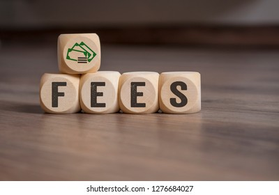 Cubes dice with fees on wooden background