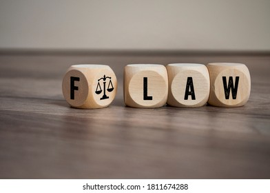 Cubes and dice with Flaw and Law on wooden background