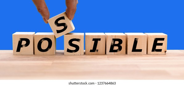 """Cubes form the word """"POSSIBLE"""""""