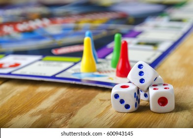 Cubes with the game monopoly on the table