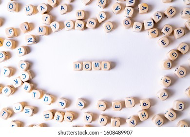 """Cubes with letters building the word """"Home"""" in the middle of random cubes laying around"""
