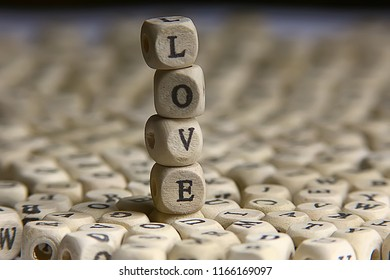 cubes letters love inscription / message from small letters, the concept of romance love, inscription love unusual font