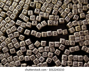 cubes with letters on a black background, with the word password about education, training, knowledge and information