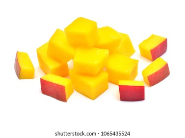 Cubes mango fruit with and without peel isolated on white background. Juicy, wholesome vitamins