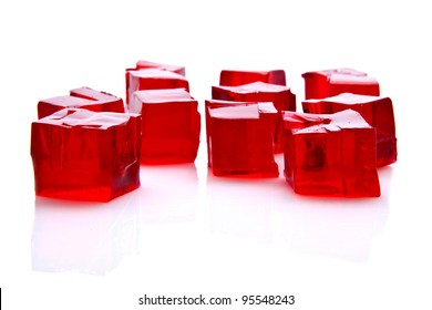 Cubes of red jelly on white background
