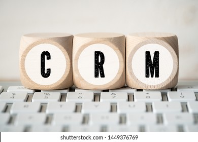 "cubes showing the acronym ""CRM"" on a computer keyboard"