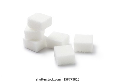 Cubes of sugar on white background