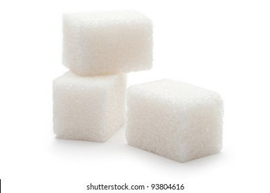 Cubes of sugar on the white background