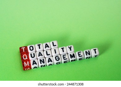 cubes with text ,TQM Total Quality Management  on green background