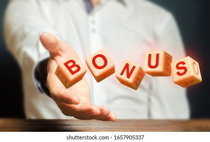 Cubes thrown by a man make word BONUS. Receive bonuses, rewards and preferences. Salary increase, wage premium for holidays.Favorable purchase and special promotions. Rising at work. A nice addition