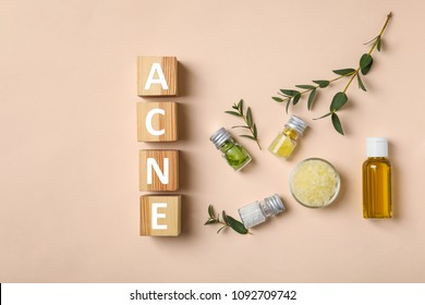 "Cubes with word ""Acne"" and ingredients for homemade problem skin remedy on light background"