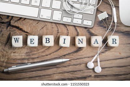 "cubes with word ""webinar"" on wooden background"